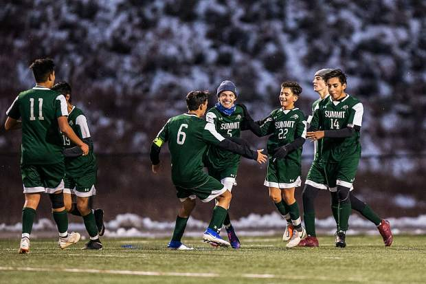 The Tigers celebrate Owen Gallo's (22) goal against Steamboat in the first half at Summit High School in Breckenridge on Tuesday, Oct. 22.