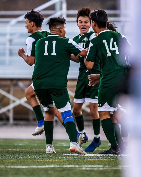 The Tigers celebrate Fabian Cuevas' goal in the first half of Summit's 1-0 upset win over Glenwood Springs at Summit High in Breckenridge on Thursday.