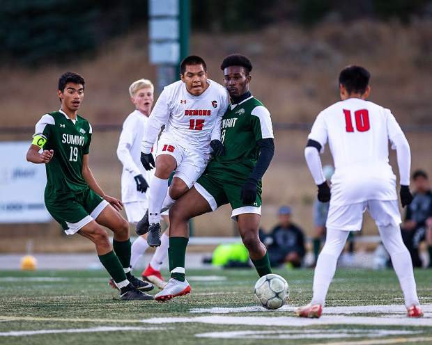 Summit High's Ivan Gutierrez (19) and Maschelle Kepple (8) battle Carlos Rodriguez (15) for the ball in the first half of Summit's 1-0 win over Glenwood Springs Thursday night at Tiger Stadium in Breckenridge.