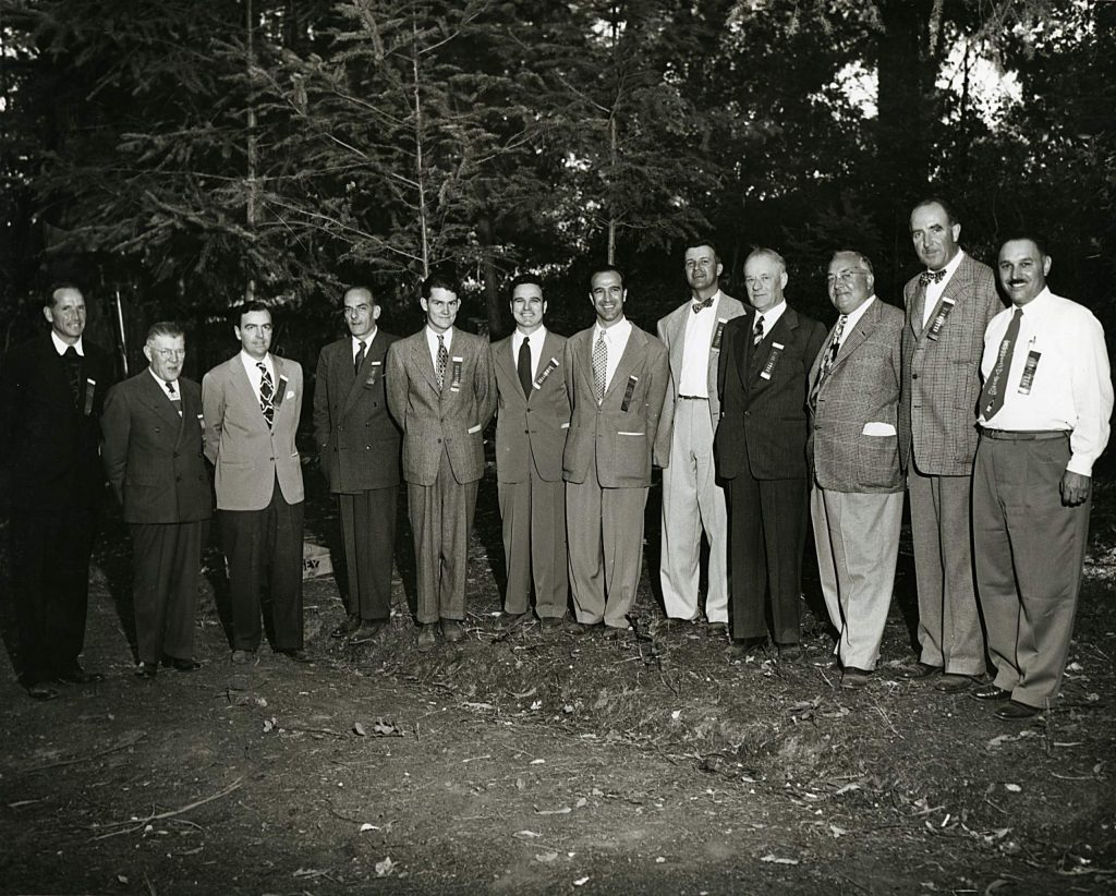 Early gatherings of the members of the Napa Valley Vintners were social affairs and focused as much on marketing and promotion as other issues. Here, in 1949, members including Robert Mondavi, Louis Martini and Charles Beringer pose for a photo at a luncheon prepared for the Harvard Club, which visited the Napa Valley that September.
