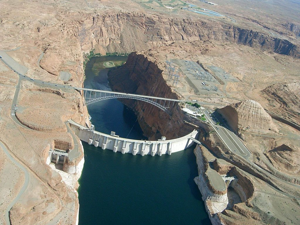 Seen from the air, Glen Canyon Dam holds back the Colorado River to form Lake Powell. The state of Colorado is looking into how to fund a program that would pay irrigators to reduce their consumptive use in order to send water downstream to a savings account in Lake Powell.