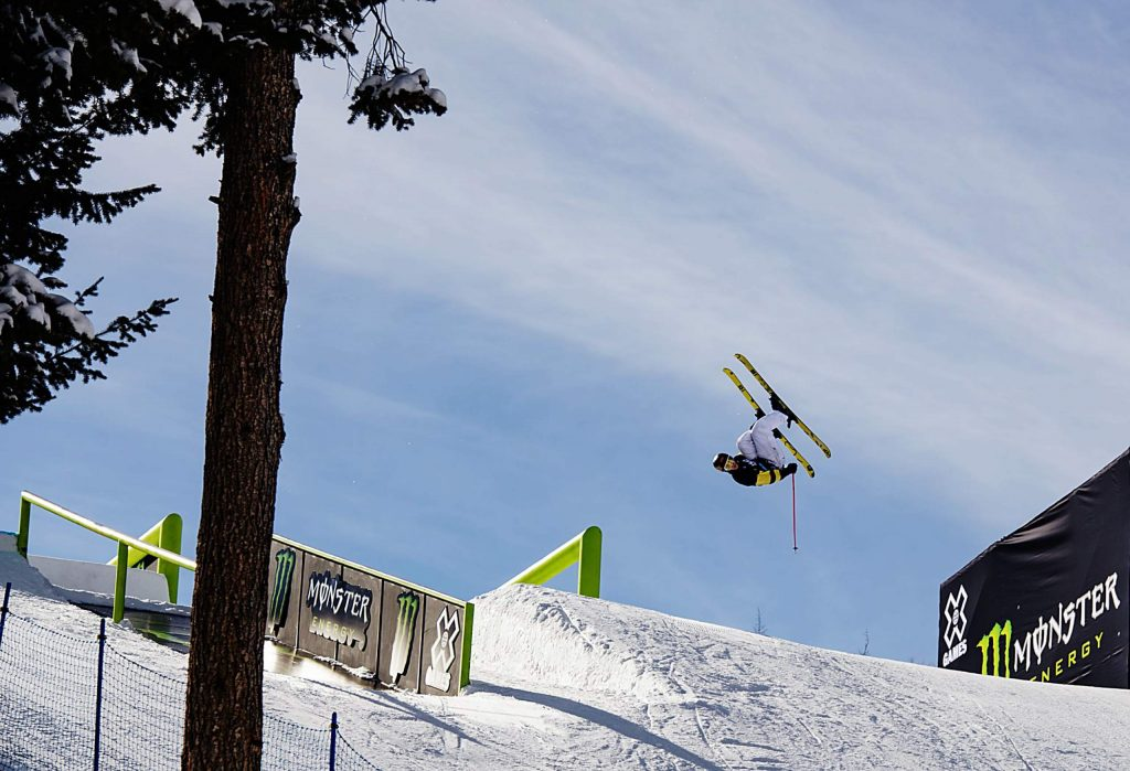 Birk Rudd flips off the third set of rails on the slopestyle course during the men's ski slopestyle qualifying event on Friday, Jan. 24, 2020. (Kelsey Brunner/The Aspen Times)