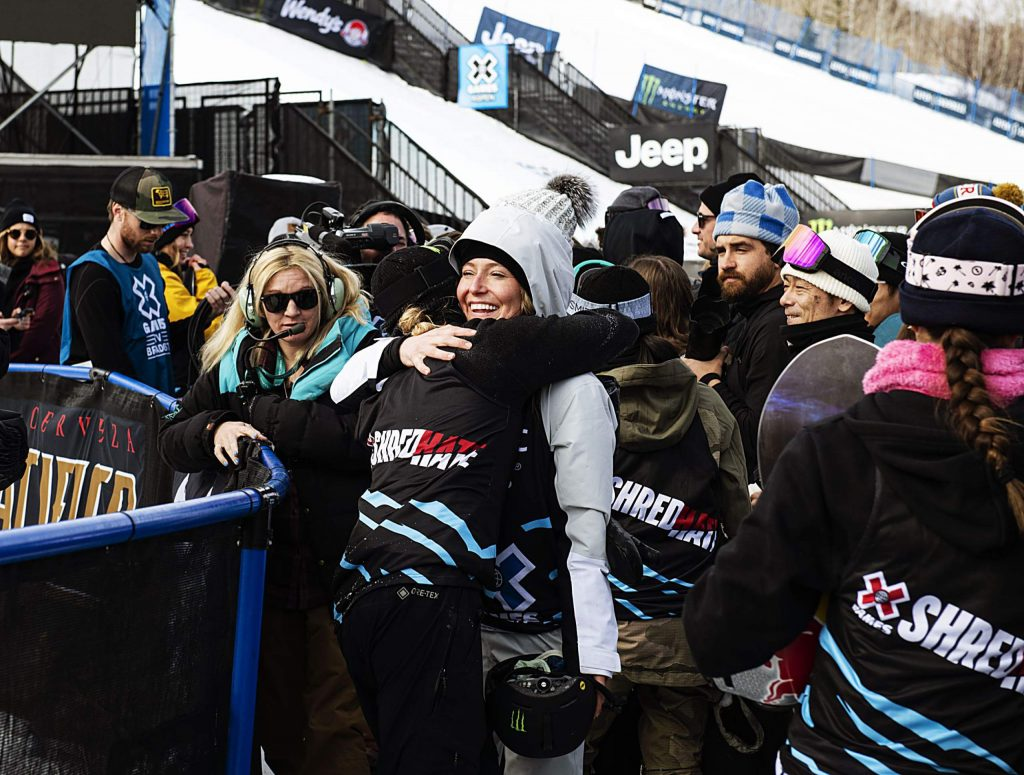 X Games gold medalist Jamie Anderson hugs competitor Zoi Sadowski-Synnott after the end of the women's snowboard slopestyle event on Saturday, Jan. 25, 2020. (Kelsey Brunner/The Aspen Times)