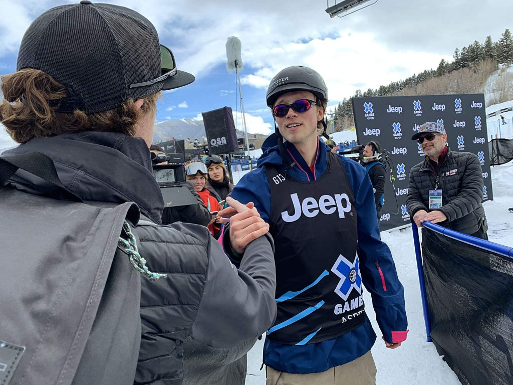 X Games gold medalist Colby Stevenson, right, gets congratulated by fans and media after the men's ski slopestyle final on Saturday.