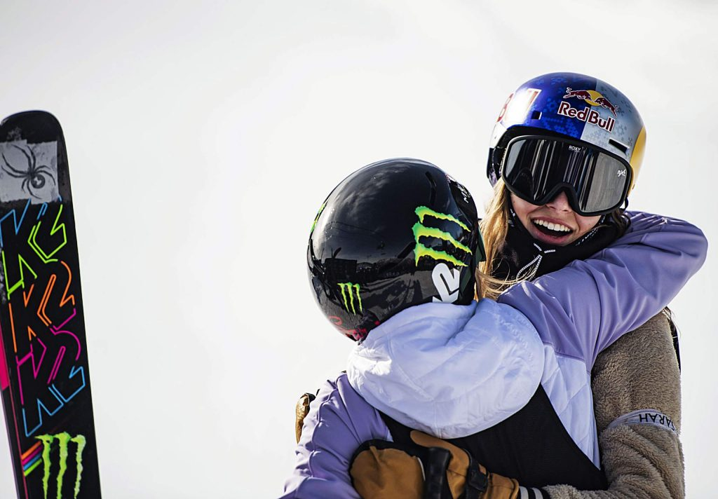 X Games skiers Maggie Voisin, left, and Kelly Sildaru hug after Sildaru finished her last run of the women's slopestyle final on Sunday, Jan. 26, 2020. Sildaru took home the gold and Voisin took home bronze. (Kelsey Brunner/The Aspen Times)