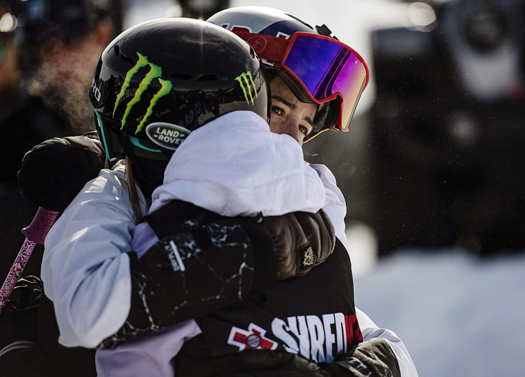 X Games skier Mathilde Gremaud, right, hugs Maggie Voisin after she finished in third place at the women's ski slopestyle final on Sunday, Jan. 26, 2020. (Kelsey Brunner/The Aspen Times)
