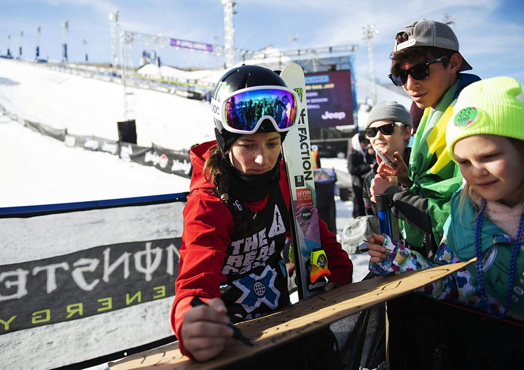 X Games skier Sarah Hoefflin signs autographs for Aspen Girl Scouts after finishing with a silver medal at the women's ski slopestyle final on Sunday, Jan. 26, 2020. (Kelsey Brunner/The Aspen Times)