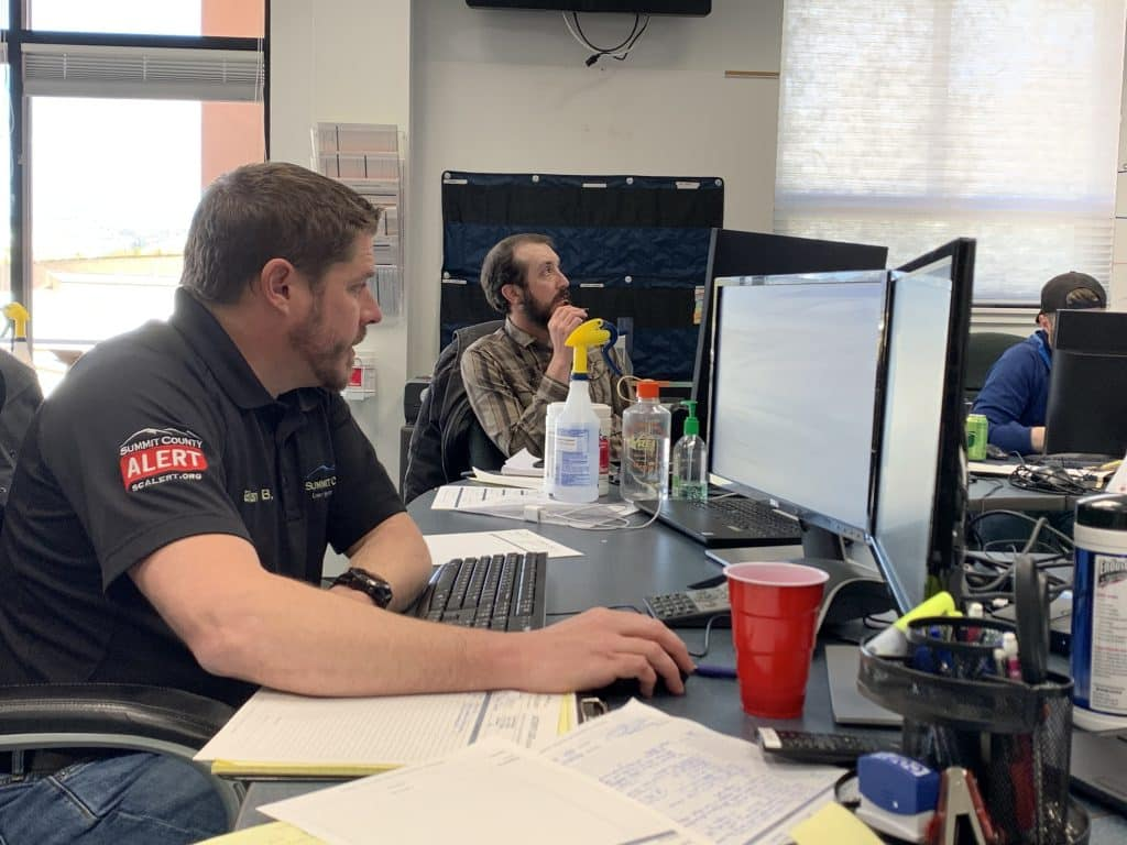 Summit County Emergency Management Director Brian Bovaird leads a daily phone briefing with community leaders around the county.