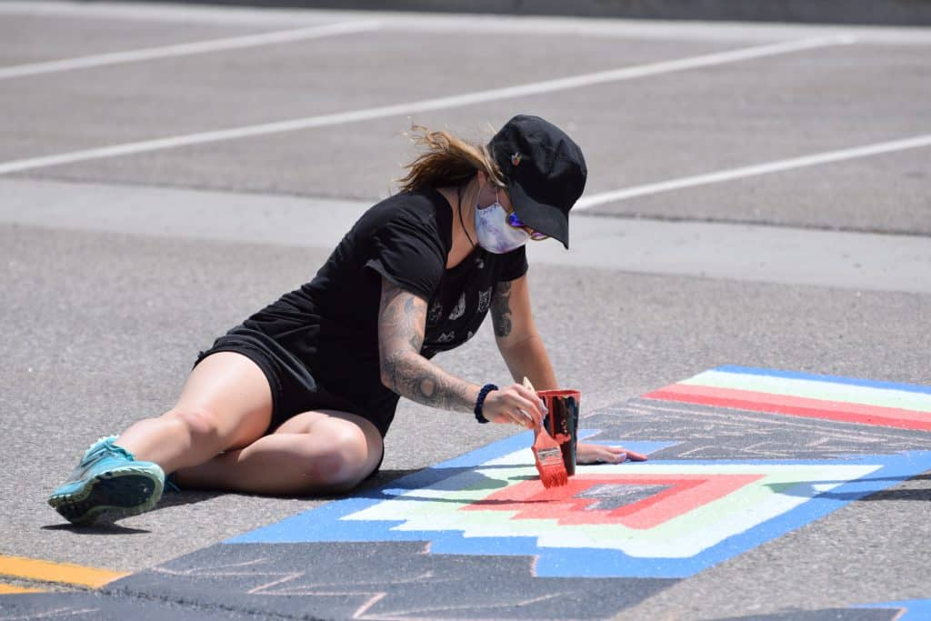 Silverthorne resident Kellie Rogers, who painted the mural inside of HighSide Brewery, works on the letter K of the Black Lives Matter mural Tuesday, July 14. Her contribution features trees, mountains and other outdoor images.