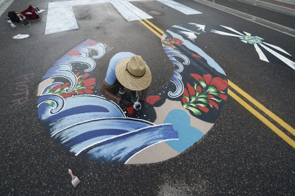 Piotr Olimpiusz Kopytek, of Frisco's Blue Herron Tattoo, puts the finishing touches on the S of the Black Lives Matter mural on Frisco's Main Street on Tuesday, July 14.