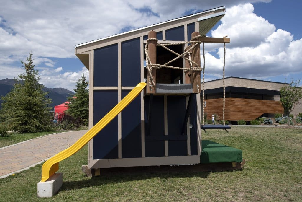 MW Golden Constructors' playhouse features a slide and swing. The playhouses will be auctioned off at the end of the public exhibit, with proceeds benefiting the Family and Intercultural Resource Center's (FIRC) affordable housing programs.